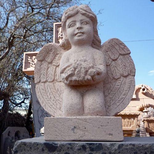 Angel holding flowers, Escolastica, Cantera