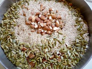 Dry ingredients for granola - oats, nuts, seeds