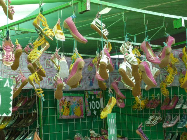 Green pink and yellow shoe stand