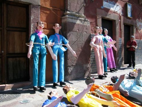 Paper mache Judas figures lined up in the Jardin
