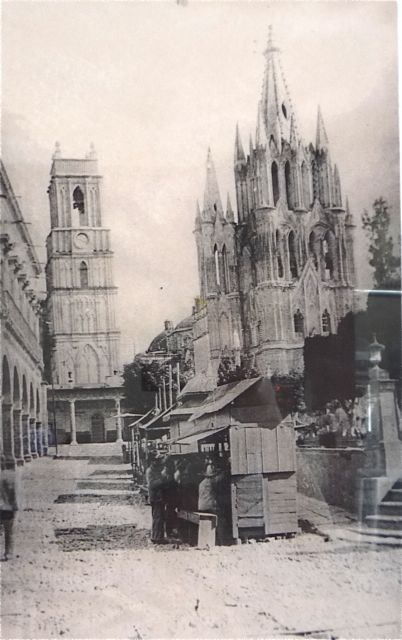The Parroquia and Tower from the corner of Calle San Francisco - notice the cobblestones in the street and the wood cart street vendors.
